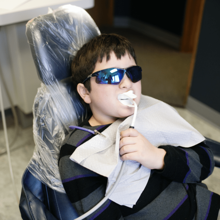 kid at dentist with emergency dental care carmel indiana